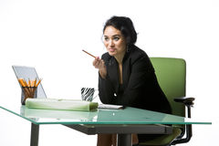 Pretty young businesswoman sitting at her desk Royalty Free Stock Images