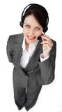 Pretty young businesswoman talking on a headset Royalty Free Stock Photo