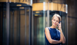 Pretty, young businesswoman talking on the phone Stock Photography