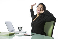Pretty young businesswoman tired and yawning Stock Photos