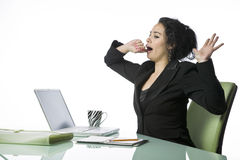 Pretty young businesswoman tired and yawning Royalty Free Stock Photo