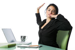 Pretty young businesswoman tired and yawning Stock Photo