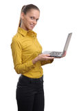 Pretty young businesswoman working on laptop Royalty Free Stock Image