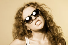Pretty young capricious beautiful girl in sunglasses Royalty Free Stock Image