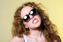 Pretty young capricious beautiful girl in sunglasses Royalty Free Stock Images