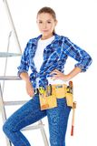Pretty Young Carpenter Woman on Steel Ladder Stock Photos