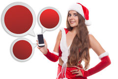 Pretty young Caucasian brunette woman with knitted Santa hat sho Royalty Free Stock Photos