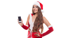 Pretty young Caucasian brunette woman with knitted Santa hat sho Royalty Free Stock Images