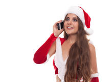 Pretty young Caucasian brunette woman with knitted Santa hat tal Royalty Free Stock Photo