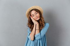 Pretty young caucasian lady showing sleep gesture Stock Image