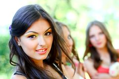 Pretty young caucasian woman with friends Royalty Free Stock Photo