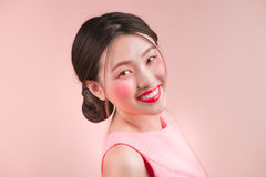 Pretty young charming smiling woman close-up on a pink backgroun Royalty Free Stock Photo