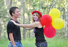 Pretty young cheeky woman flirting with cute man stock photos