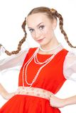 Pretty young cheerful woman  with ridiculous  plaits in russian folk costume. Posing at white background, isolated stock photography