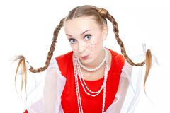 Pretty young cheerful woman  with ridiculous  plaits in russian folk costume. Posing at white background, isolated royalty free stock photo