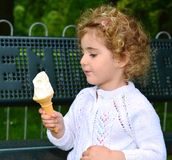 Pretty young child, girl, eating an ice cream. Royalty Free Stock Photography