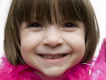 Pretty young child smiling. A lovely adorable young child with sweet smile royalty free stock photos