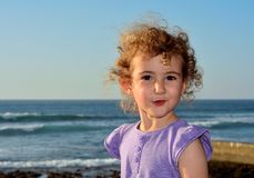 Pretty young child walking on the beach. Stock Image