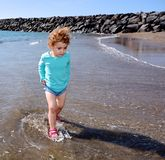 Pretty young child walking on the beach. Royalty Free Stock Photography
