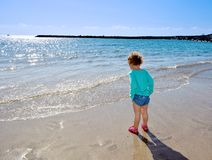 Pretty young child walking on the beach. Stock Photo