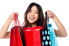 Pretty young chinese girl holding shopping bags Royalty Free Stock Photo