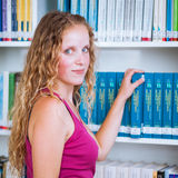 Pretty, young college student female  student in a library Stock Image
