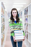 Pretty, young college student in a library Stock Photo