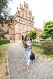 Pretty young college student smiling happy, holding a backpack are a walk to class in the University royalty free stock photography