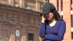 Crying Woman Wearing Hat And Wig. A pretty young Colombian adult female stock video