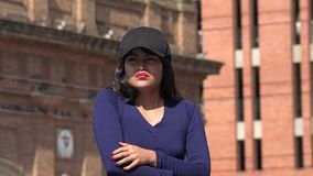 Fearful woman wearing hat and wig. A pretty young Colombian adult female stock video footage