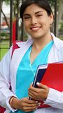 Student Nurse Cute Girl. A pretty young Colombian adult female Stock Image