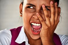 Cute School Girl Under Stress. A pretty young Colombian teen girl stock images