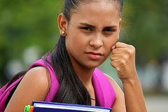 Girl Student And Anger. A pretty young Colombian teen girl Royalty Free Stock Photo
