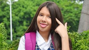 Goofy Minority Person. A pretty young Colombian teen girl Stock Photos