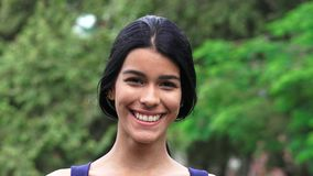 Latina Teenage Girl Smiling. A pretty young Colombian teen girl royalty free stock image