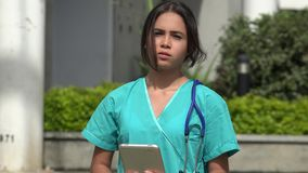 Serious Female Nurse. A pretty young Colombian teen girl stock video footage