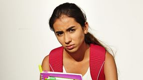Serious Girl Student. A pretty young Colombian teen girl Royalty Free Stock Image