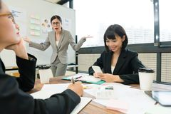 Pretty young company female business manager. Looking at employees feeling angry when she finding they don`t joining meeting report stock image