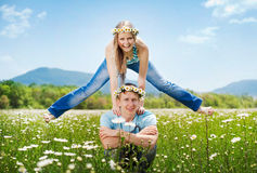 Pretty young couple. In the fields Royalty Free Stock Photography
