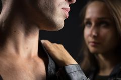 Pretty young couple in biker jackets Stock Image