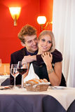 Pretty Young Couple having Date at Restaurant. Stock Photos