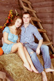 Pretty young couple having dating in the hayloft Royalty Free Stock Photo