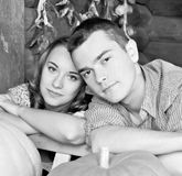 Pretty young couple having dating in the hayloft Stock Photography