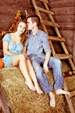 Pretty young couple kissing and dating in the hayloft Royalty Free Stock Photography