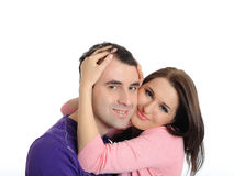 Pretty young couple in love embracing. isolated Stock Photography