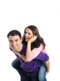 Pretty young couple in love embracing. isolated Stock Images