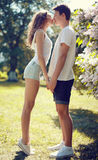 Pretty young couple in love, sensual kiss. In sunny warm day Royalty Free Stock Photo