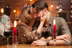 Pretty young couple making each other laugh in a vintage restaurant royalty free stock image