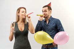A pretty young couple man and woman with a happy emotion to celebrate the holiday, birthday, new year, congratulations stock images