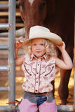 Pretty young cowgirl. Royalty Free Stock Image